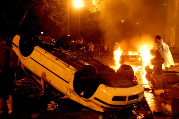 Hungarian Riots 2006 a car upside down
